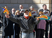 An unidentified man waves Catalonian flags on the street in front of the Palau de la Generalitat de Catalunya as he and others advocate for Catalonian independence from Spain on Tuesday, November 7, 2017. The building is a historic palace in Barcelona, Catalonia, that houses the offices of the Presidency of the Generalitat de Catalunya Barcelona. <br /> Credit: Ron Sachs / CNP