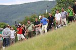 Graeme McDowell takes his second shot from the side of ahill on the 18th on the final day of the Celtic Manor Wales Open 2010.Picture Fran Caffrey/Newsfile.ie
