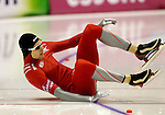 Norway's Even Johansen falls during the men's World Sprint Speed Skating Championships in Heerenveen January 22, 2011. REUTERS/Michael Kooren (NETHERLANDS)