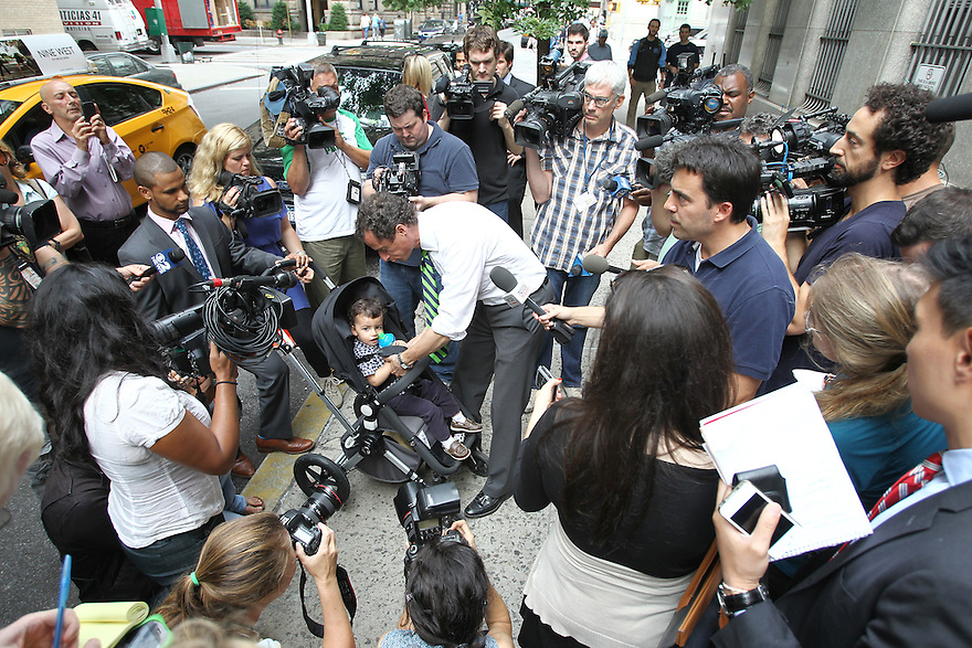 Mayoral candidate Anthony Weiner with son Jordan speaks to the media after voting in the New York City Mayoral Primary on Tuesday, Sept. 10, 2013 New York. (AP Photo/ Donald Traill)