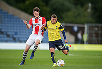 Joe Rothwell of Oxford United holds off Liam McAlinden of Exeter City during the The Checkatrade Trophy match between Oxford United and Exeter City at the Kassam Stadium, Oxford, England on 30 August 2016. Photo by Andy Rowland / PRiME Media Images.