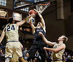 SIOUX FALLS, SD - MARCH 9:  Brent Smith #12 of Southewestern #12 of Southwestern shoots over Cornerstone defenders Lance Martin #24 and Sam Vander Sluis #42 at the 2018 NAIA DII Men's Basketball Championship at the Sanford Pentagon in Sioux Falls. (Photo by Dick Carlson/Inertia)