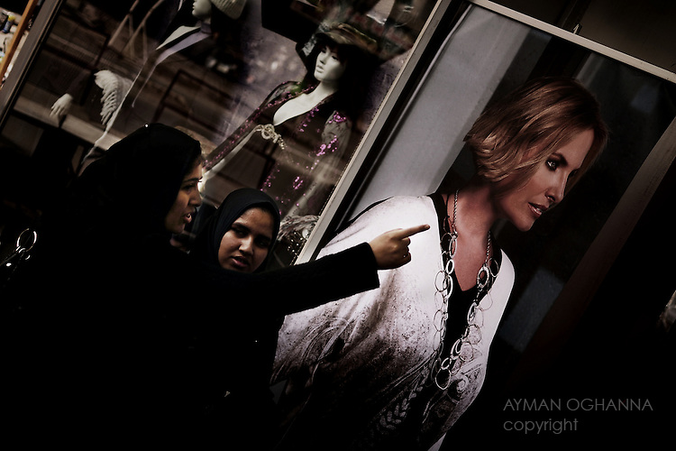 Baghdad, Iraq  : Thur 4rd Dec 2009 :..Young women shop outside a female fashion store in Karrada, Baghdad' s commercial district. As the Iraqi government imposes an ethical crackdown, questions over moral and Islamic values have once again hit Baghdad's streets...Ayman Oghanna For The Observer