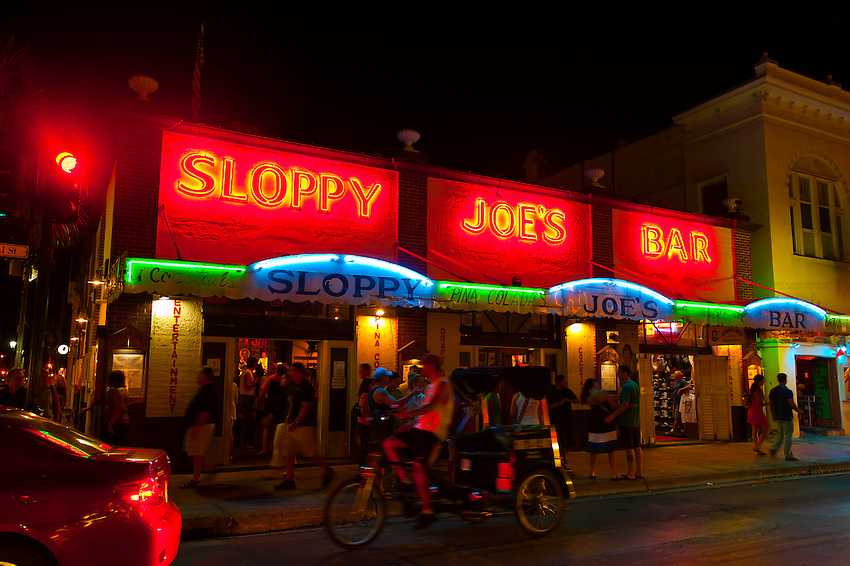 Pedicab passing in front of Sloppy Joe's Bar, Duval Street, Key West, Florida Keys, Florida USA