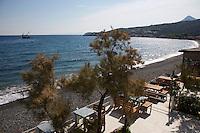 Lipsos Hotel (Ata'nin Yeri) with the town of Karaburun in the background, Karaburun Peninsula, Turkey