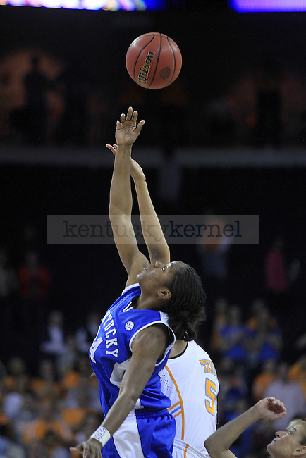 Junior guard Victoria Dunlap tips the ball during the first half of the UK women's basketball game against Tennessee for the SEC tournament at the Gwinnett Center on Sunday, March 7, 2010. Photo by Adam Wolffbrandt | Staff