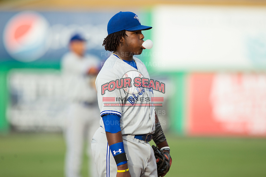 Bluefield Blue Jays third baseman Vladimir Guerrero Jr. (27) blows a bubble while on defense during the game against the Burlington Royals at Burlington Athletic Stadium on June 28, 2016 in Burlington, North Carolina.  The Royals defeated the Blue Jays 4-0.  (Brian Westerholt/Four Seam Images)