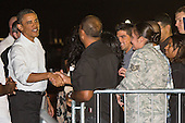 United States President Barack Obama greets well-wishers before boarding Air Force One for the return flight to Washington at Joint Base Pearl Harbor-Hickam on Saturday January 5, 2013 in Honolulu, Hawaii..Credit: Kent Nishimura / Pool via CNP