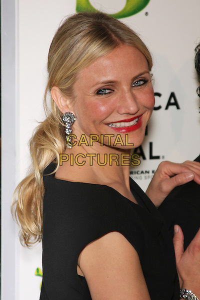 """CAMERON DIAZ.The World Premiere of """"Shrek Forever After"""" & Opening Night of the 2010 Tribeca Film Festival held at the Ziegfeld Theatre, New York, NY, USA..April 21st, 2010 .headshot portrait red lipstick dangling side silver earrings make-up beauty smiling.CAP/LNC/TOM.©TOM/LNC/Capital Pictures."""