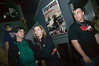 12 March 2006 - Kearny, NJ - Participants in a bus tour of locations featured in the hit television mob show The Sopranos visit the Satin Dolls men's club in Lodi, USA, known as Bada Bing in the series, as a club employee (R) looks on, 12 March 2006.