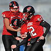 Plainedge kicker No. 18 Dylan Burns, center, gets congratulated by No. 44 Corey Hill and No. 52 Matt Aloni after he split the uprights for a 42-yard field goal during a Nassau County varsity football Conference III semifinal against Roosevelt at Hofstra University on Saturday, Nov. 14, 2015. Plainedge won by a score of 53-13.<br /> <br /> James Escher