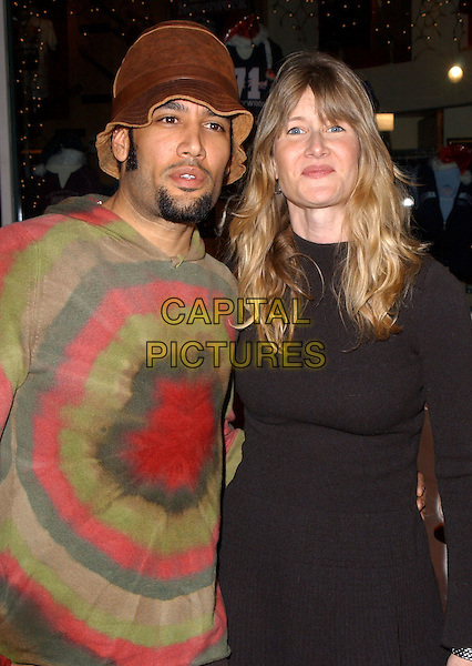 "BEN HARPER & LAURA DERN.Universal Pictures' Premiere of ""Meet The Fockers"" held at Universal City Walk in Universal City, California  December 16th, 2004.tie dye shirt, pattern, circles, black top, grey, gray trousers, hat, half length, goatee, facial hair.www.capitalpictures.com.sales@capitalpictures.com.Supplied By Capital PIctures"
