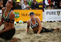 Susan Blundell watches as Anna Scarlett is unable to reach the ball during the 2009 McEntee Hire NZ Beach Volleyball Tour - Women's final at Oriental Parade, Wellington, New Zealand on Sunday, 11 January 2009. Photo: Dave Lintott / lintottphoto.co.nz.