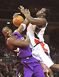 Raptors' Chris Bosh attempts a block of Omeka Okafor's shot.  The Bobcats ended their 10 game losing streak by beating the Raptors at home 101 to 94 Friday night.