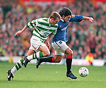Rino Gattuso leads the ball away from Tom Boyd during the Old Firm match at Celtic Park