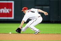 Apr. 12, 2011; Phoenix, AZ, USA; Arizona Diamondbacks shortstop Stephen Drew fields a ground ball in the first inning against the St. Louis Cardinals at Chase Field. Mandatory Credit: Mark J. Rebilas-