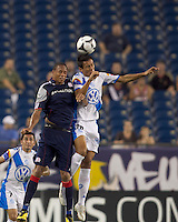 New England Revolution forward Khano Smith (18) and second half substitute Puebla FC defender Roberto Juarez (26) battle for head ball. The New England Revolution defeated Puebla FC in penalty kicks, in SuperLiga 2010 semifinal at Gillette Stadium on August 4, 2010.