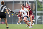 CHAPEL HILL, NC - MAY 12: Elon's Melanie McHugh (behind) knocks the ball away from Virginia's Maggie Jackson (14). The Elon University Phoenix played the University of Virginia Cavaliers on May 12, 2017, at Fetzer Field in Chapel Hill, NC in an NCAA Women's Lacrosse Tournament First Round match. Virginia won the game 11-9.