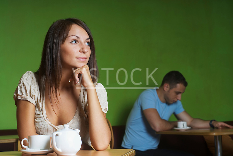 Man and woman sitting in cafe