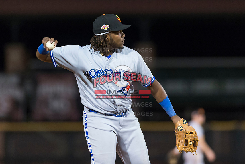 Surprise Saguaros third baseman Vladimir Guerrero Jr. (27), of the Toronto Blue Jays organization, throws during an Arizona Fall League game against the Scottsdale Scorpions at Scottsdale Stadium on October 15, 2018 in Scottsdale, Arizona. Surprise defeated Scottsdale 2-0. (Zachary Lucy/Four Seam Images)