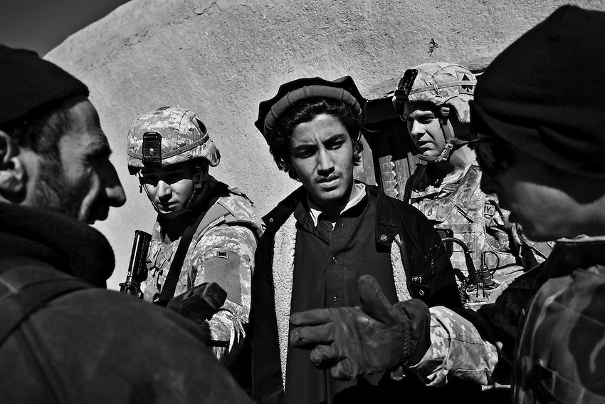 Members of 1/506th Infantry, Scout Platoon, and the Afghan National Army question an Afghan man during an operation in Shamamolzi, Paktika province, Afghanistan, Sunday, Feb. 8, 2009.