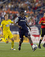 New England Revolution midfielder Shalrie Joseph (21) attempts to control the ball. The New England Revolution tied Columbus Crew, 2-2, at Gillette Stadium on September 25, 2010.