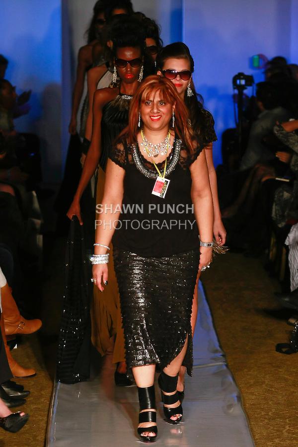 Fashion designer  Samina Mughal, walks the runway with models at the close of her Samina Mughal Fall 2012 Untamed Ferocious Glamour collection, during Plitzs Fashion Week New York Fall 2012.