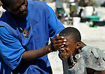 Water is a scarce commodity in Port-au-Prince, the dusty capital of Haiti, which was ravaged by a January 12 earthquake. Here a boy gets his face washed with water from a project sponsored by Norwegian Church Aid, a member of the ACT Alliance.