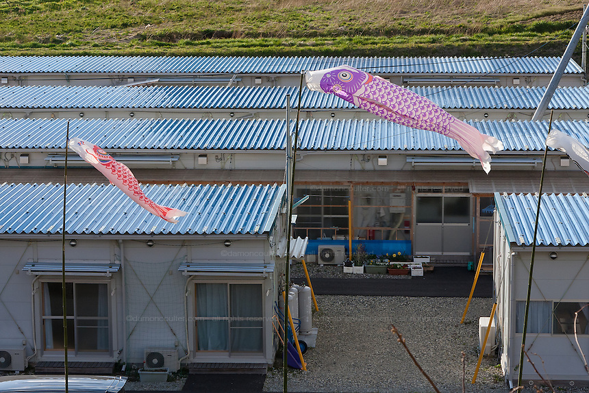 Koinobori (carp flags) fly over temporary housing units on the outskirts of Miharu, Tamura District of Fukushima, Japan, Wednesday May 1st 2013. Many people were moved into temporary housing after the earthquake and tsunami of march 11th 2011 left people homeless due to their houses being flattened in the tsunami or contaminated by radiation from the accident at Fukushima Daichi nuclear power station.