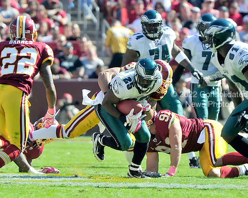 Philadelphia Eagles running back LeSean McCoy (25) carries the ball in the second quarter against the Washington Redskins at FedEx Field in Landover, Maryland on Sunday, October 16, 2011.  He was tackled by Redskins safety LaRon Landry (30). The Eagles won the game 20 - 13..Credit: Ron Sachs / CNP