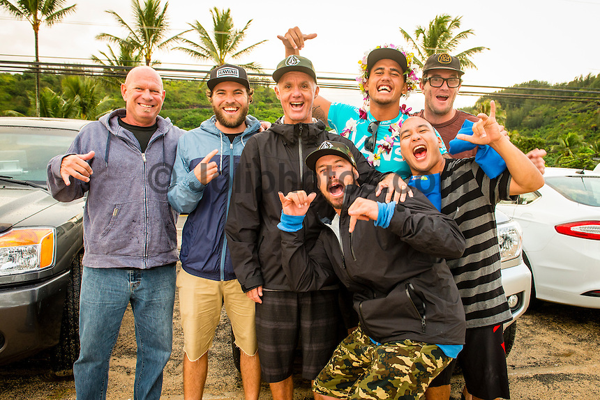 North Shore, Oahu, Hawaii (Sunday, Dec. 1, 2013) Jeff Bushman (HAW), Dylan Payne (HAW), Dave Riddle (HAW), Jason Shibata (HAW) and  Matt Bemrose (AUS) with Ezekiel. -- Hawaii's own Ezekiel Lau, 20, posted the largest victory of his young career today by winning the prestigious 39th annual VANS World Cup of Surfing at Sunset Beach - the second stop of the Vans Triple Crown of Surfing. Lau's win earned him $40,000 and sees him close the year at 35th position on the ASP world rankings. While that doesn't qualify him for next year's elite World Championship Tour, it does guarantee him an excellent seed. He also holds a shared lead on the coveted Vans Triple Crown series rankings with Michel Bourez (PYF) heading into the third and final event of the series - the Billabong Pipe Masters, where he is a local wildard entry.<br /> <br /> Lau made a late tube-riding charge from behind to turn the tables on Damien Hobgood (USA) and Raoni Monteiro (BRA) in the latter half of the 30-minute final. Fourth place was Frederico Morais, (PRT), who was announced the JN Chevrolet Rookie of the 2013 Vans Triple Crown. Lau went on the hunt and found his way onto the biggest waves of the final that also offered high-scoring tube riding potential. His final scoreline was 15.5 points out of 20 (8.67 and 6.83 point rides). Hobgood was second on 14.3; Monteiro third with 12.33, and Morais on 7.16.Photo: joliphotos.com