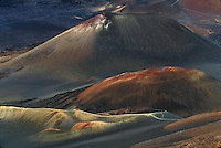 Three multi colored cinder cones which dominate the natural landscape of the crater inHALEAKALA NATIONAL PARK on Maui in Hawaii