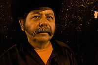 Portrait of a &quot;Trio&quot; member. <br /> <br /> In northern mexico bands known as &quot;trios&quot; are well known for their services, private playings. In restaurants, bars or in the street is often see them offering songs, from traditional mexican music like mariachis, banda, corridos to classic rock.