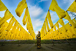Workers hang out yellow threads to dry by Khanh Phan
