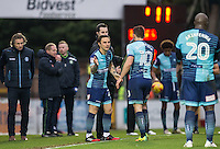 Sam Saunders of Wycombe Wanderers replaces Matt Bloomfield of Wycombe Wanderers during the Sky Bet League 2 match between Wycombe Wanderers and Crawley Town at Adams Park, High Wycombe, England on 25 February 2017. Photo by Andy Rowland / PRiME Media Images.