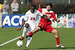 15 November 2009: Virginia's Tony Tchani (23) and NC State's Alan Sanchez (10). The University of Virginia Cavaliers defeated the North Carolina State University Wolfpack 1-0 at WakeMed Stadium in Cary, North Carolina in the Atlantic Coast Conference Men's Soccer Tournament Championship game.