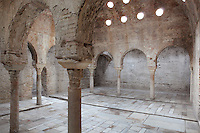 El Banuelo, or the Banos del Nogal, an 11th century bathhouse in Zirid style, in El Albayzin, the medieval Moorish old town of Granada, Andalusia, Southern Spain. The entrance to the baths is in a house, remodelled in the Christian period, with a patio that opening to the original house of the watchman. Inside is a hall with access to 3 thermal rooms, cold, warm and hot. The hot room has an underground hypocaust for heating the room and 2 water containers. The barrel vaults have skylights for ventilation and temperature adjustment. From the 8th to the 15th centuries, Granada was under muslim rule and retains a distinctive Moorish heritage. Granada was listed as a UNESCO World Heritage Site in 1984. Picture by Manuel Cohen