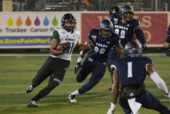 Hawaii running back Fred Holly III (21) runst against Nevada in the first half of an NCAA college football game in Reno, Nev. Saturday, Sept. 28, 2019. (AP Photo/Tom R. Smedes)