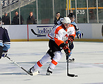 OMAHA, NE - FEBRUARY 9:  Robbie Baillargeon #18 from the Omaha Lancers pushes the puck past Jimmy Devito #20 from the Lincoln Stars in the first period at the Battle on Ice Saturday at TD Ameritrade in Omaha, NE. (Photo by Schyler Eggen/Inertia)