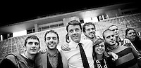 Matteo Renzi takes a picture with some supporters using an iphone during his political campaign convention for the Partito Democratico's primary elections -Italian left wing Party - in Turin, October 21, 2012.