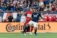 FOXBOROUGH, MA - AUGUST 25: Brandon Bye #15 of New England Revolution intercepts pass to Przemyslaw Frankowski #11 of Chicago Fire during a game between Chicago Fire and New England Revolution at Gillette Stadium on August 24, 2019 in Foxborough, Massachusetts.