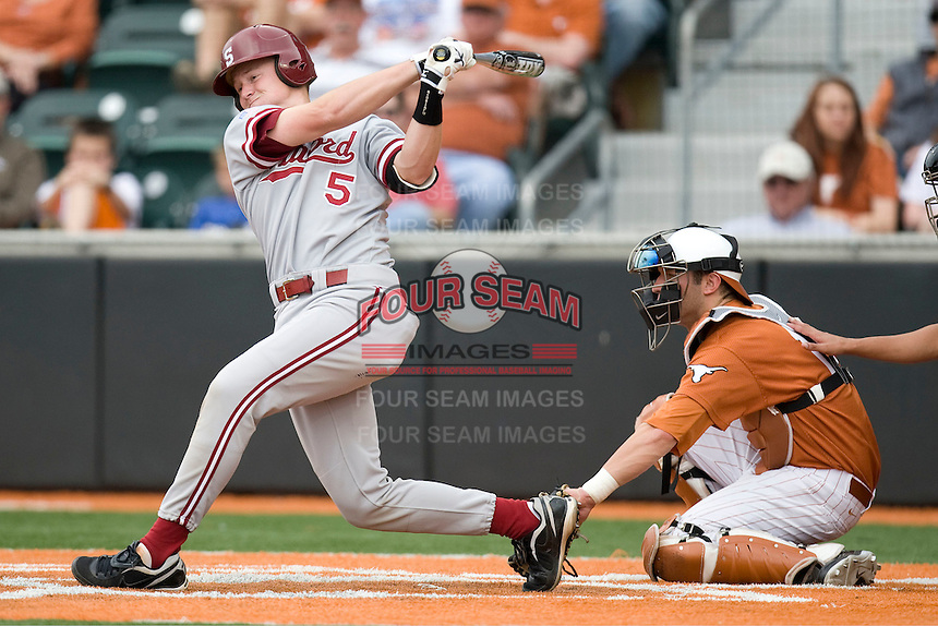 Stanford catcher Zach Jones follows through against Texas on March 4th, 2011 at UFCU Disch-Falk Field in Austin, Texas.  (Photo by Andrew Woolley / Four Seam Images)