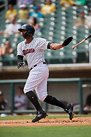 Birmingham Barons left fielder Eloy Jimenez (21) follows through on a swing hits a two run double during a game against the Pensacola Blue Wahoos on May 9, 2018 at Regions FIeld in Birmingham, Alabama.  Birmingham defeated Pensacola 16-3.  (Mike Janes/Four Seam Images)