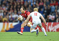 Wales's William Harries evades the tackle of England's John Brake<br /> <br /> Wales Vs England - men's classification 5th - 6th place match<br /> <br /> Photographer Chris Vaughan/CameraSport<br /> <br /> 20th Commonwealth Games - Day 4 - Sunday 27th July 2014 - Rugby Sevens - Ibrox Stadium - Glasgow - UK<br /> <br /> © CameraSport - 43 Linden Ave. Countesthorpe. Leicester. England. LE8 5PG - Tel: +44 (0) 116 277 4147 - admin@camerasport.com - www.camerasport.com