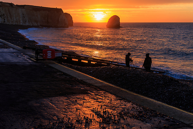People enjoying a winter sunrise at Freshwater Bay, Isle of Wight