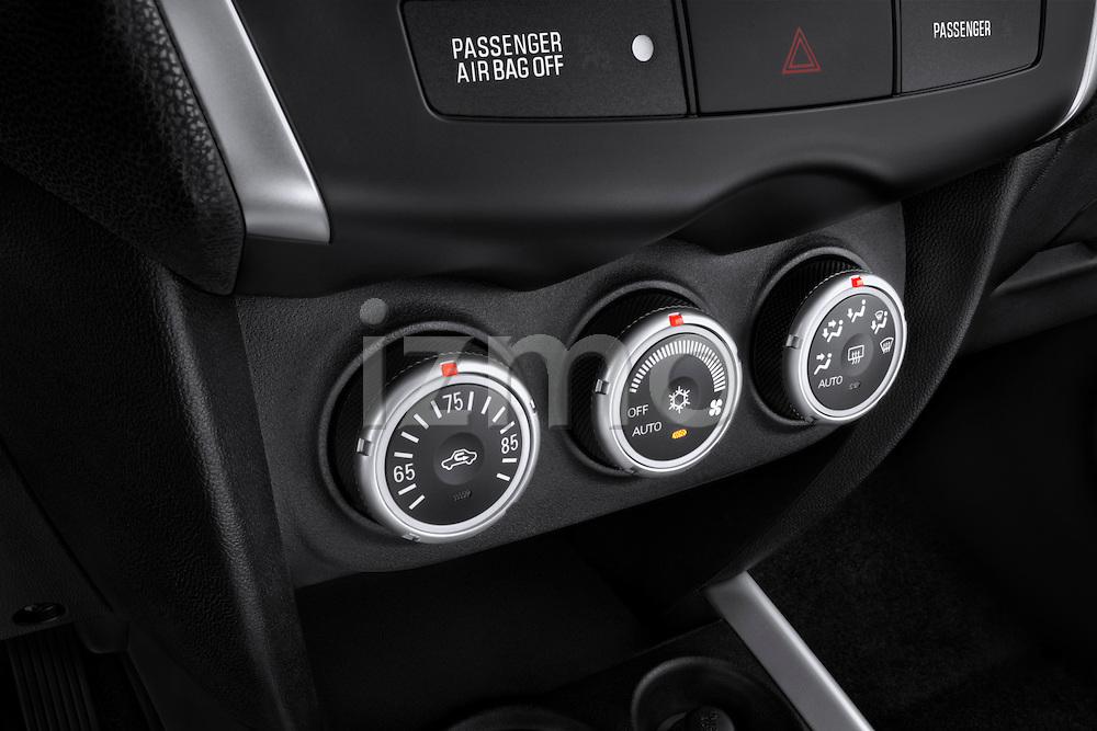 Climate controls closeup view of a 2011 Mitsubishi Outlander Sport SE