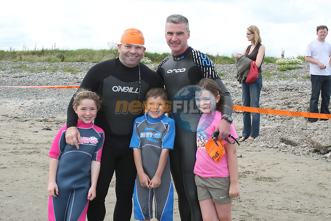 Mark Connell and Alan Heade who were taking part in the triatlon pictured here with their children Emma and Ben Connell and Aisling Heade in Clogherhead...Photo NEWSFILE/Jenny Matthews.(Photo credit should read Jenny Matthews/NEWSFILE)....This Picture has been sent you under the condtions enclosed by:.Newsfile Ltd..The Studio,.Millmount Abbey,.Drogheda,.Co Meath..Ireland..Tel: +353(0)41-9871240.Fax: +353(0)41-9871260.GSM: +353(0)86-2500958.email: pictures@newsfile.ie.www.newsfile.ie.FTP: 193.120.102.198.