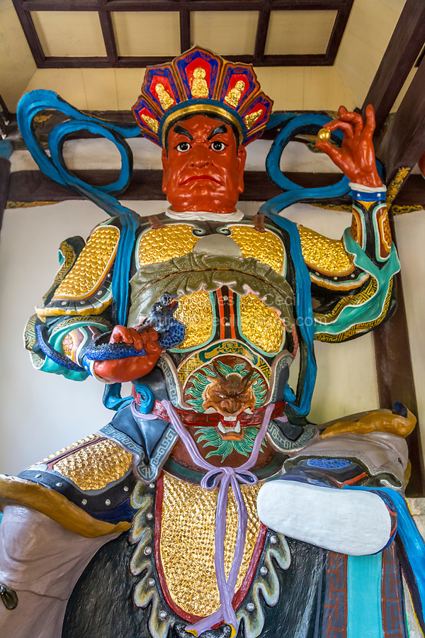 Wenzhou, China.  Jiangxin Buddhist Temple.  Guang Mu Tianwang, one of the four heavenly kings.  King of the West and One Who Sees All.
