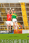 Andrew Garnett of Kerry competes with Cork's Andrew O'Sullivan last Wednesday night in Pairc Ui Chaoimh, Cork in the Munster GAA Junior Football Championship.