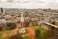 Bird's eye view of The Big Ben like clock tower called Torre de los Ingleses (the Englishmen's tower) renamed Torre Monumental (Monumental Tower) on the Plaza San Martin Square renamed Plaza de la Fuerza Aerea or Plaza Fuerza Retiro. Retiro railway station in the background. The harbour to the right Buenos Aires Argentina, South America